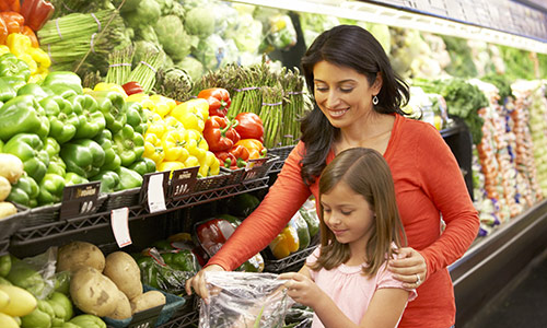 Mother Involving her Daughter in Food Choices