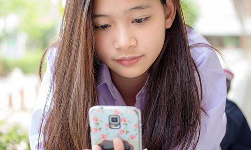 Teenager Using a Smartphone